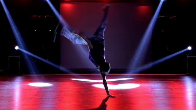 hip-hop dancer  dances on stage in the club - young singles stock videos and b-roll footage