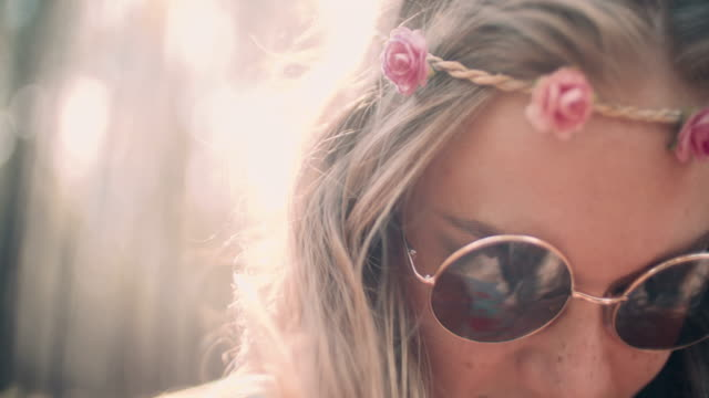 Hippie girl fashion shot in a forest with sun flare video