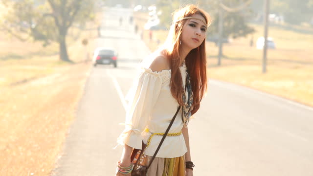 Hippie girl hitchhiking video