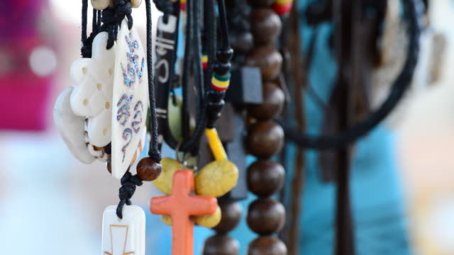 Hippies and tribal necklaces hanging in stall hawking crafts video