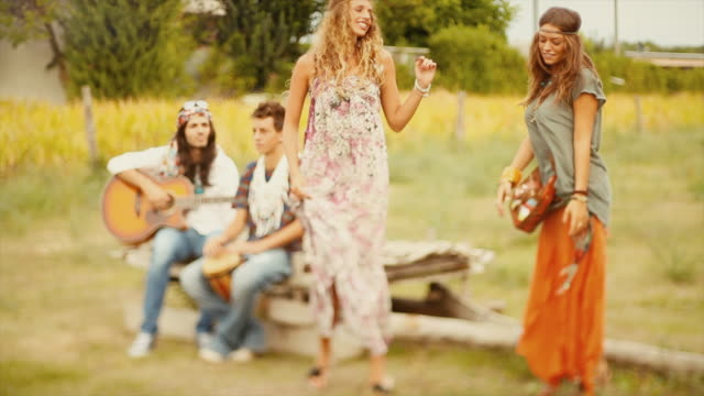Hippies: old fashioned group of friends video