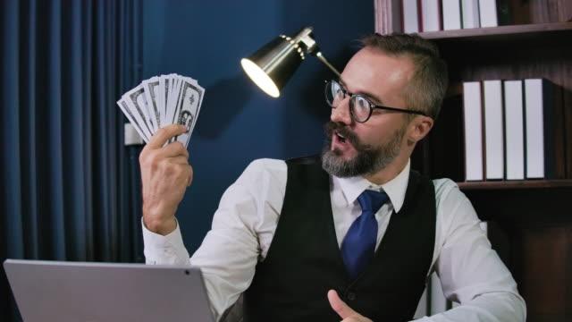 Hipster businessman show money.