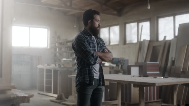 Hipster carpenter prepared for hard day at office! Bearded carpenter prepared for had day at workshop carpenter stock videos & royalty-free footage