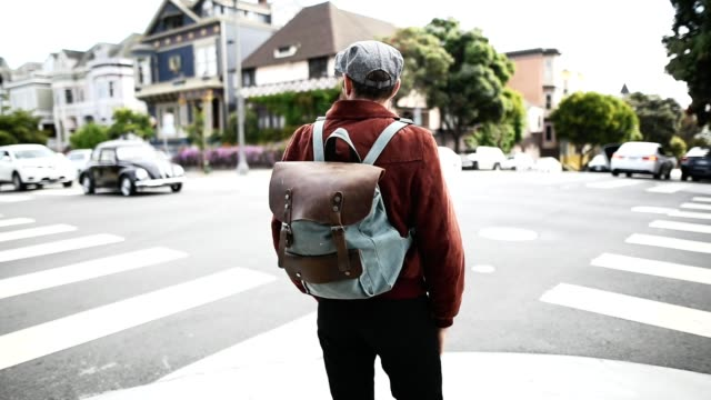 hipster crossing the street in san francisco - preppy fashion stock videos and b-roll footage