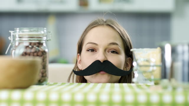 Hipster girl with fake mustaches video