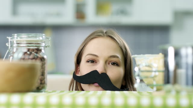 hipster girl with fake mustaches - baffo peluria del viso video stock e b–roll