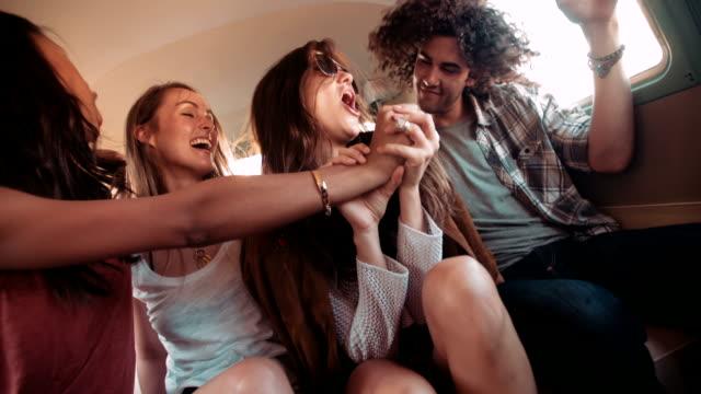 Hipster Girls friends playing karaoke in van video