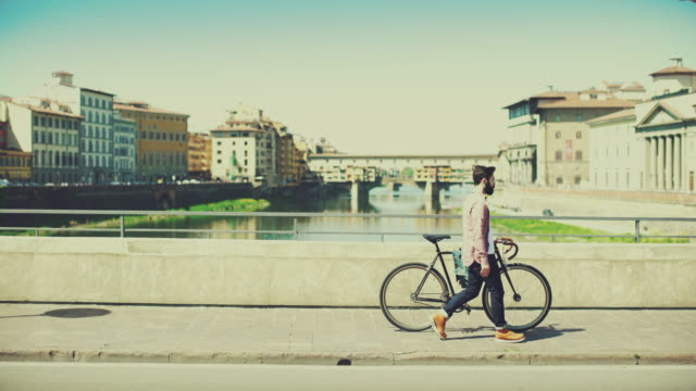 Hipster guy with bicycle in Florence, Italy
