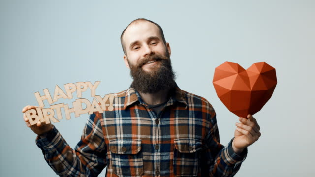 Hipster man showing and giving you a Happy Birthday text