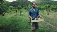 istock Hipster man with grocery box 607327670