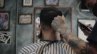 istock Hipster men cutting hair to customer. 1270825641