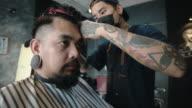 istock Hipster men cutting hair to customer. 1270827402
