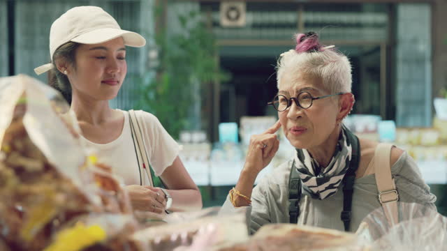 Hipster mother and young lady buy food-stock video video