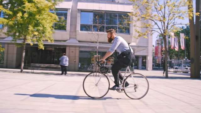 SLO MO Hipster riding a bicycle in the city video
