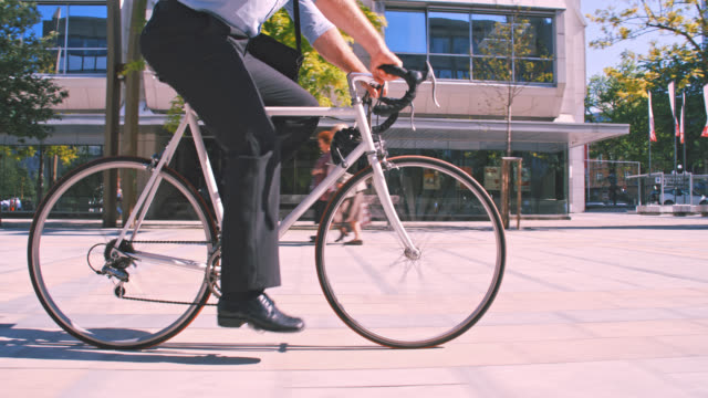 SLO MO Hipster riding his bike while going to work video