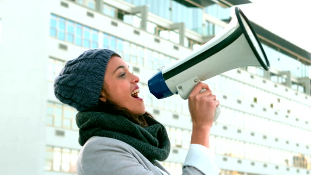 Hipster shouing through megaphone outside Hipster shouing through megaphone outside in slow motion megaphone stock videos & royalty-free footage