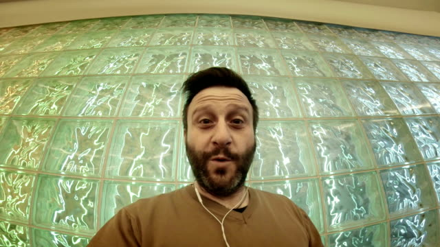 WS Hipster Taking Selfie In Front Of Glass Bricks video