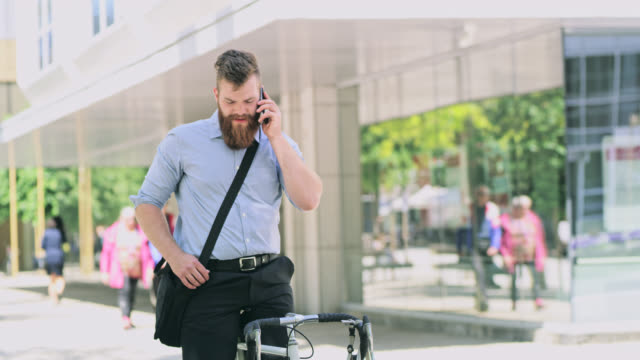 DS Hipster talking on a mobile phone on a bicycle in the city video