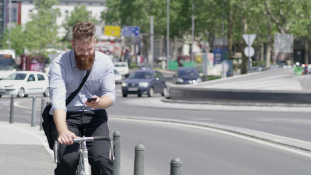 WS Hipster text messaging while riding a bike in the city video