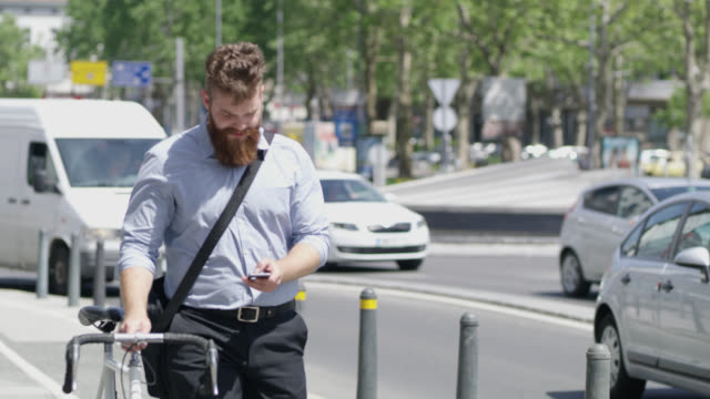 R/F Hipster using a mobile phone while walking on a sidewalk video