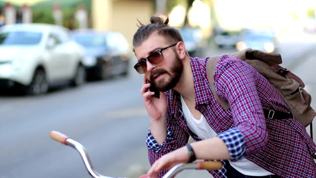 Hipster using smartphone video