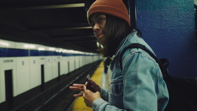 Hipster Young Woman in New York City Subway, Asian tourist waiting train in subway station platform at New York. USA railroad station platform stock videos & royalty-free footage