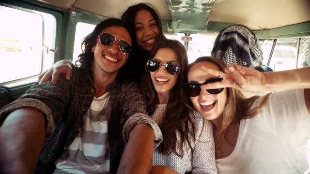 Hipster young women taking selfie inside a vintage van