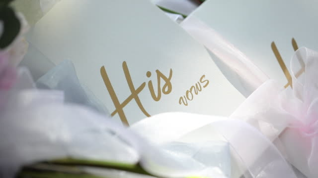 His vows and Her vows card at wedding ceremony.