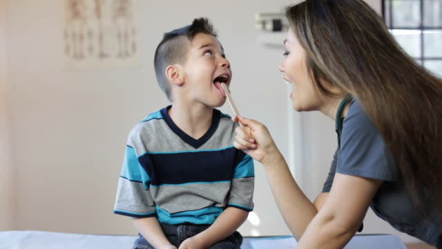 Hispanic Boy's Pediatrician Visit, Throat video