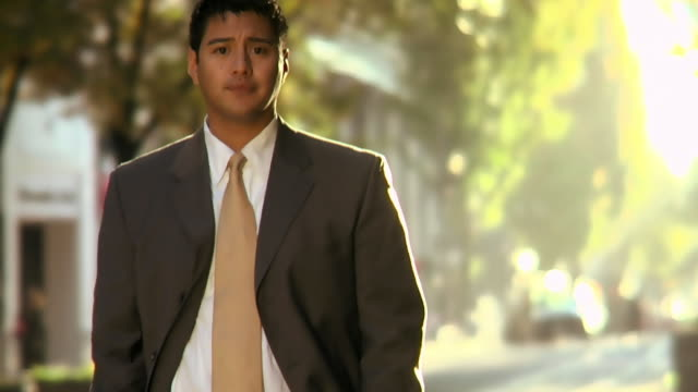 HD Hispanic businessman in city, serious to happy video