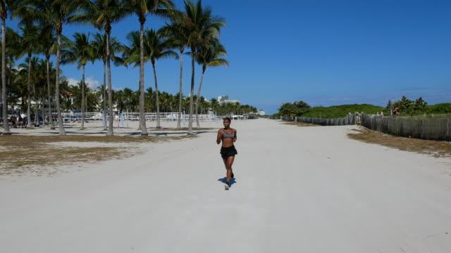 Hispanic Caribbean woman jogging in the morning near the beach in Miami