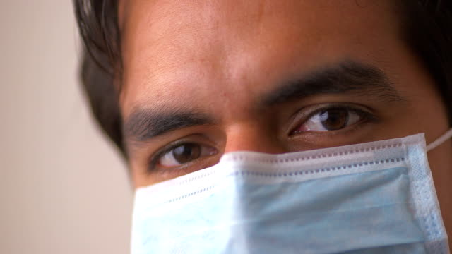 Hispanic doctor in surgical mask video