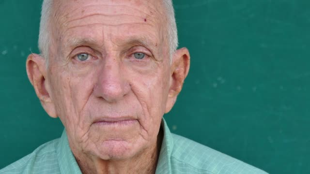 22 Hispanic Elderly People Portrait Worried Senior Man Face Expression Portrait of sad old people with emotions and feelings. Worried hispanic senior bald man looking at camera with anxious expression on face. Active retired elderly grandfather. Close-up, copy space depression land feature stock videos & royalty-free footage