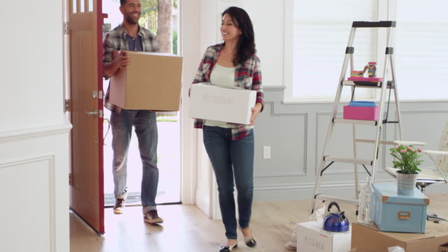 Hispanic Family Moving Into New Home Shot On R3D video