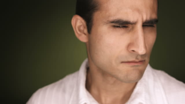 Hispanic male furrows his eye brow video