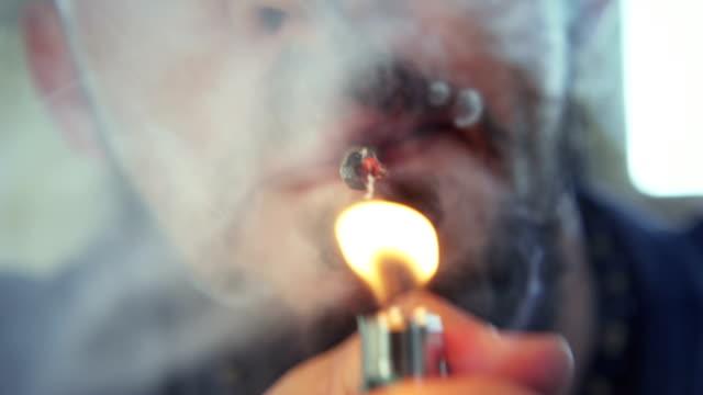 Hispanic Man Smoking Hashish Joint Marijuana Cigarette For Fun Substance abuse, drugs, narcotics and people, hispanic man smoking hashish joint at home for smoking. Young person using marijuana cigarette as recreational drug hashish stock videos & royalty-free footage