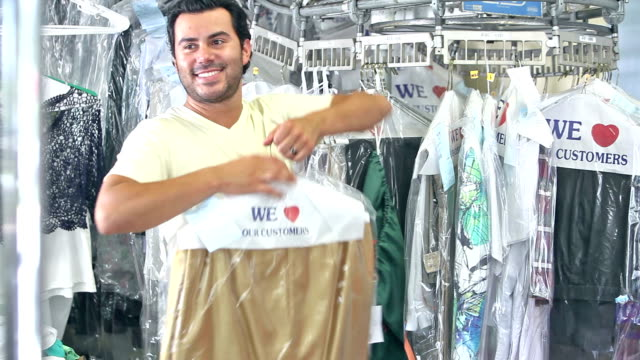 Hispanic man working at dry cleaners video