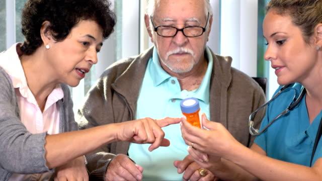 Hispanic nurse explaining medication to senior couple