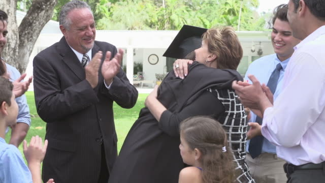 Hispanic Student And Family Celebrating Graduation video