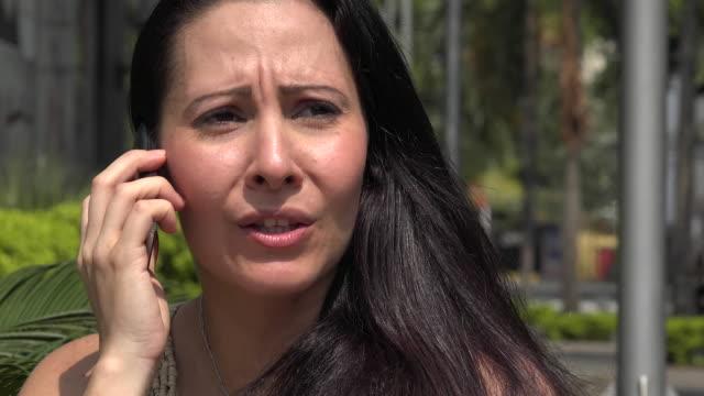Hispanic Woman Talking on Cell Phone video