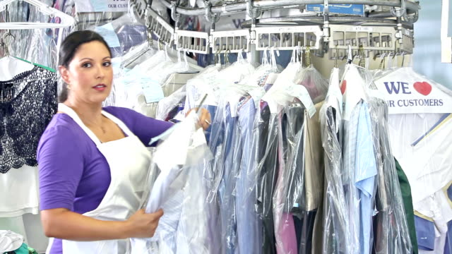 Hispanic woman working at dry cleaners video