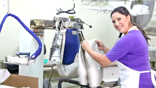 Hispanic woman working in dry cleaners video