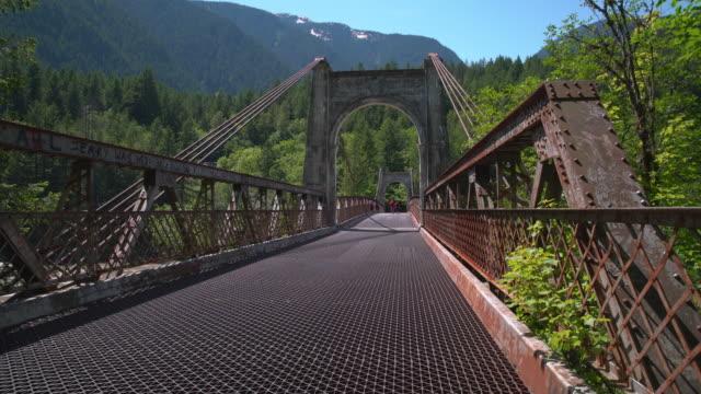 historic alexandra bridge, british columbia dolly shot 4k uhd - fiume fraser video stock e b–roll