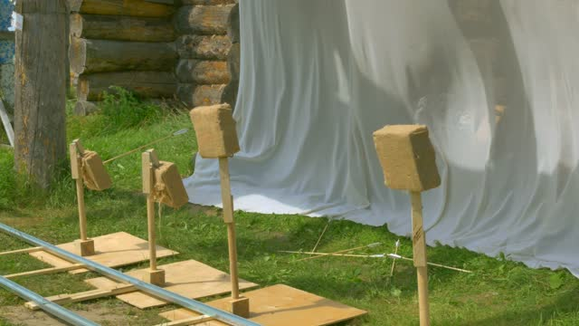 Historic Archery Tournament, target drops struck by an archer