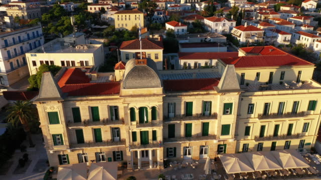 Historic building on Spetses island in Greece High-quality aero video at dawn near the Poseidon Hotel neoclassical architecture stock videos & royalty-free footage