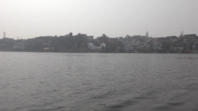 historic city of mathura and its ghats across the river yamuna from the boats. - ghat filmów i materiałów b-roll
