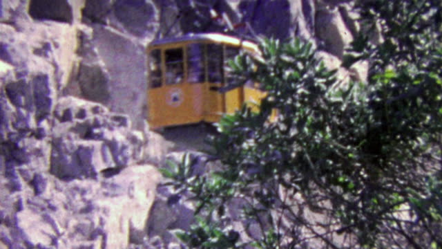 1964: Historic mountain cable suspended people transport gondola. video