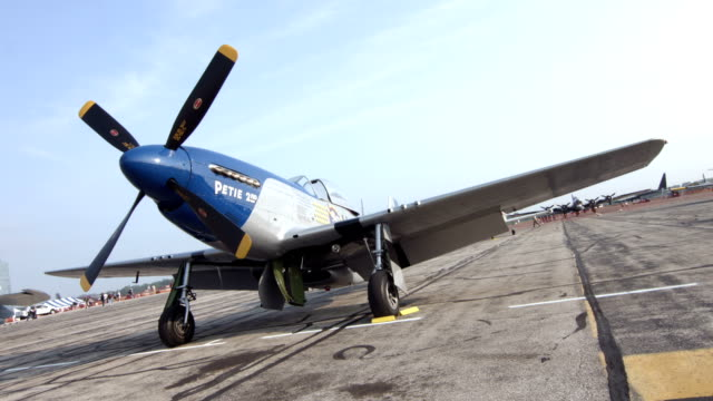 Historic P-51 Mustang fighter plane parked 24P video