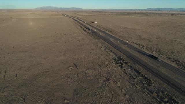vídeos de stock e filmes b-roll de historic route 66 - modern highway 40 - near in a desert near laguna, not far from albuquerque, new mexico. aerial drone video with the forward camera motion - passagem de ano