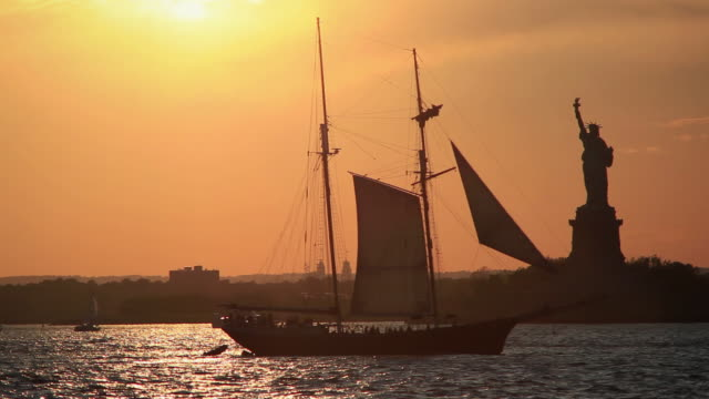 Historic sail boat and the Statue of Liberty